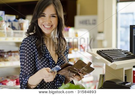 Paying at the cash register