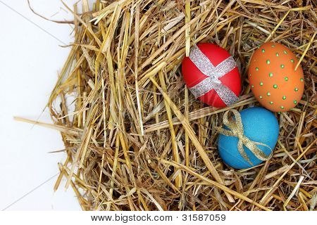Colorful Easter eggs on straw