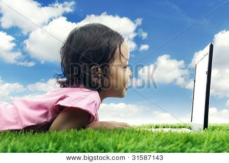 Kid With Laptop In Meadow