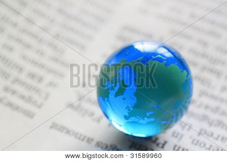 earth on  newspaper