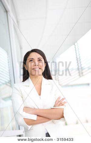 Pretty Hispanic Woman Outside School