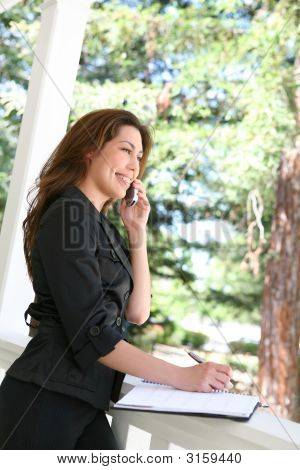Pretty Woman On Phone At Home