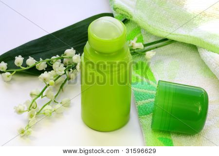Lily Of The Valley, Turkish Towel And A Green Deodorant On The Table
