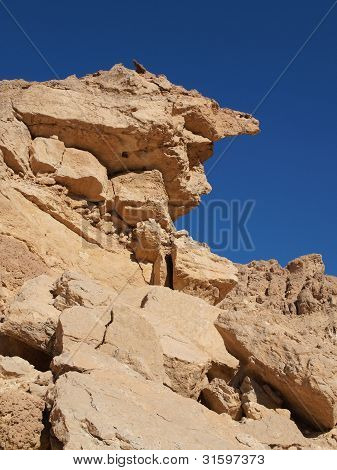 Scenic weathered yellow rock in stone desert