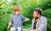 Father Teach Son Eat Natural Food. Little Boy And Dad Eat. Organic Nutrition. Healthy Nutrition Conc poster