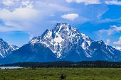 Tranquility At Grand Tetons National Park, Overlooking The Snow Mountain poster