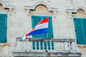 Croatian Flag On Old Building Balcony. Summer Vacation poster