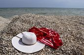 Vintage Summer Straw Beach Hat And Pareo On The Seashore. Accessories For Relaxing On The Beach. Sum poster
