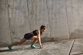 Ready, Steady Go. Motivated Sportswoman, Female Sprinter Kneel For Low Start During Morning Outdoor  poster