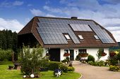 picture of economizer  - An beautiful  house roof with solar panels - JPG