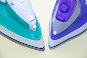 Two Irons On An Ironing Board. Selection And Comparison Of Irons. Ironing Board. poster