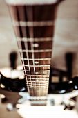 Selective Focus Shot Of Retro Classic Vintage Electric Guitar Focus On Strings, Bridge And Pickups.  poster