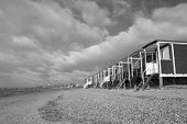 Black And White Image Of The Beach Huts At Thorpe Bay, Near Southend-on-sea, Essex, England poster