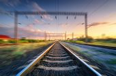Railroad And Beautiful Sky At Sunset With Motion Blur Effect In Summer. Industrial Landscape With Ra poster