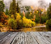 Yosemite National Park Valley and Merced River at autumn. Low clouds lay in the valley. California,  poster