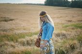 Young Girl In Hippie Clothes With Ukulele Guitar On Background Of Golden Field Of Ripe Rye poster