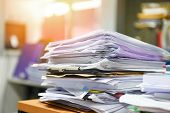 Lot Of Work Document File Working Stacks Of Paper Files Searching Information On Work Desk Office /  poster