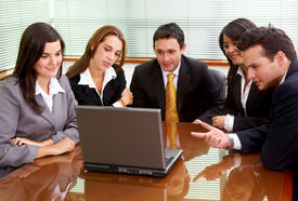 picture of business meetings  - businessmen and businesswomen in a business meeting in an office smiling - JPG