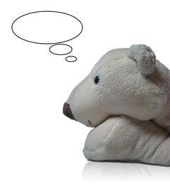 stock photo of stuffed animals  - muzzle and forefoot of white thinking bear white background - JPG