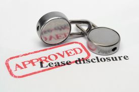 picture of rental agreement  - Close up of two locks onLease disclosure - JPG