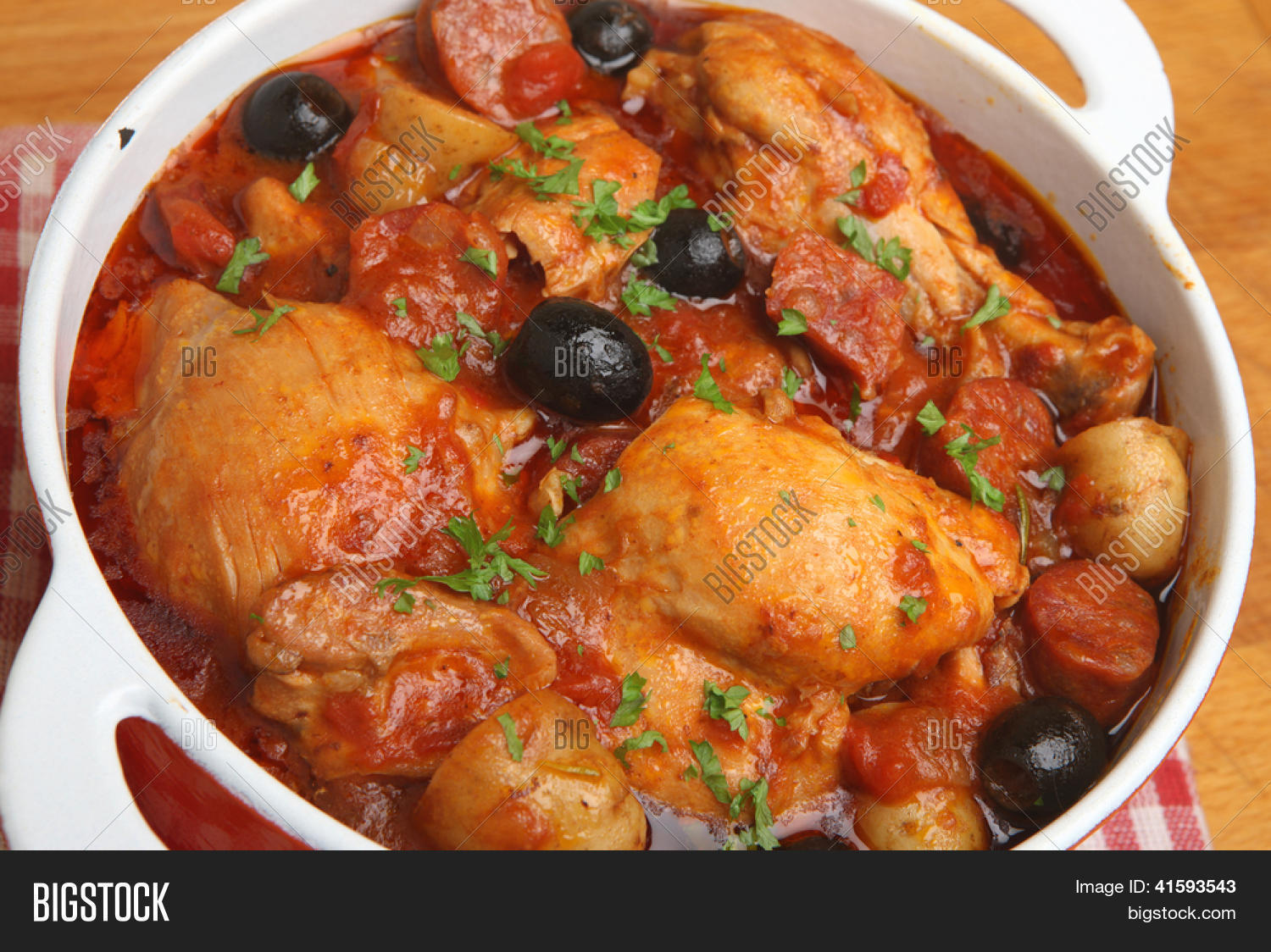 Spanish chicken casserole with chorizo, olives and new potatoes. Stock ...
