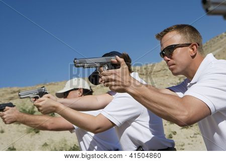 Troops holding guns on training