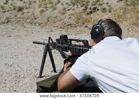 Closeup of a man in shooting position on shooting range