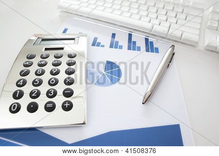 Financial concept. Stock chart with calculator, keyboard  and pen