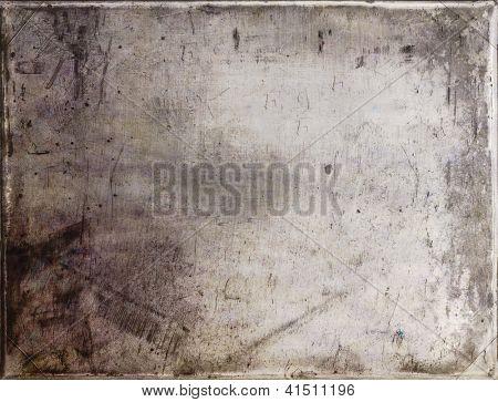 Grunge background reminiscent of old photo paper. Useful design element.