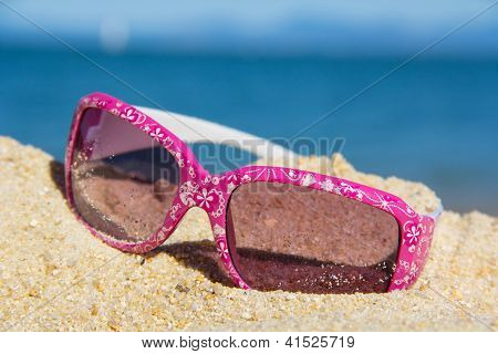 pink suglasses near the sea