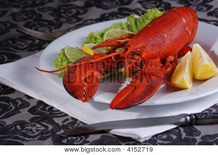 Lobster Dinner Served On Plate With Lemon
