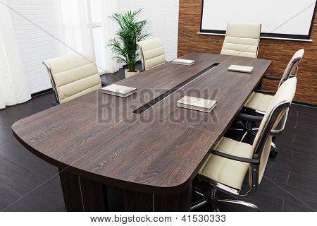 conference table with the screen in the office