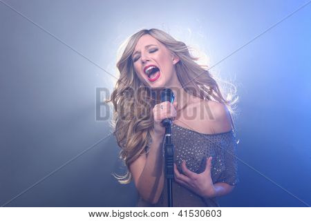 Blonde Rock Star on Stage Singing and Performing