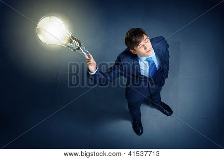 Top view of young businessman making decision
