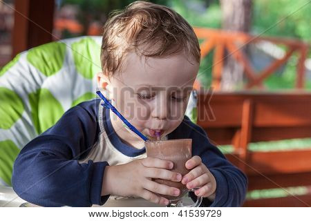 Kid Drinking A Chocolate Cocktail