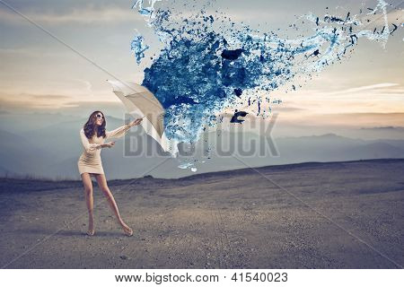 Woman in white protecting herself with a white umbrella from a blue paint