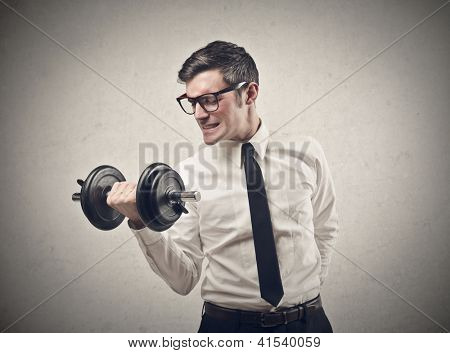Office worker raising a dumbbell