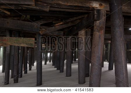 SEASIDE HEIGHTS, NJ - JAN 13: Damaged wooden pilings that support the Casino Pier on January 13, 2013 in Seaside Heights, New Jersey. Clean up continues 75 days after Hurricane Sandy struck in 2012.