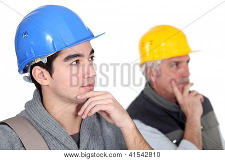 Two pensive construction workers.