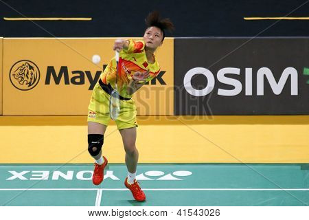KUALA LUMPUR - JANUARY 15: China's Yao Xue smashes the shuttlecock during her qualifying match at the Maybank Malaysia Open 2013 Badminton event on January 15, 2013 in Kuala Lumpur, Malaysia.