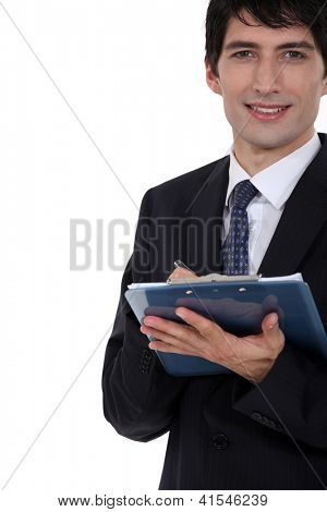 Man with clip-board taking notes