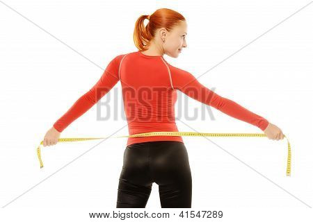 Young red woman with measuring tape