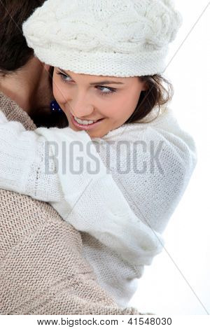 Coulpe enjoying winter hug