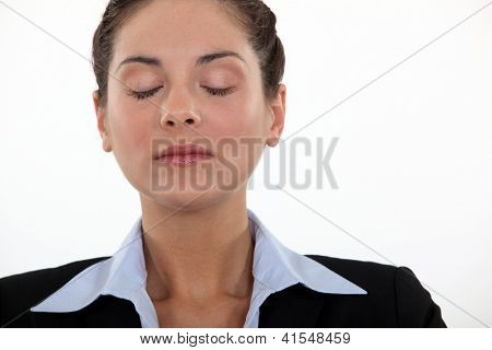 Businesswoman with her eyes closed