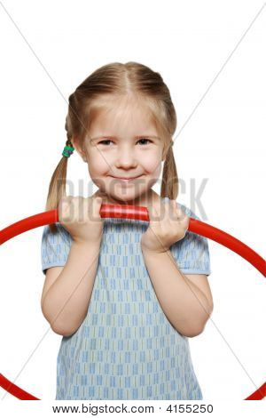 A Smiling Girl With A Gymnastic Hoop