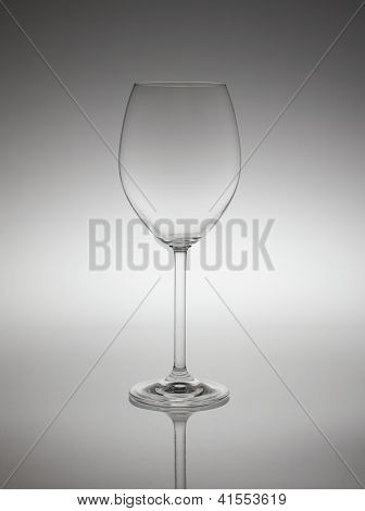 Empty Wine Glass In Back Light.