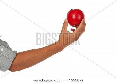 Arm with hand holding an apple