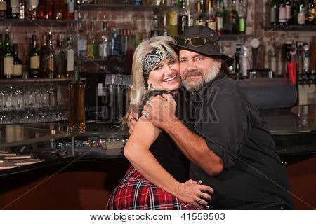 Happy Biker Couple Embracing