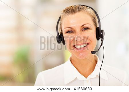 happy middle aged businesswoman with headphones