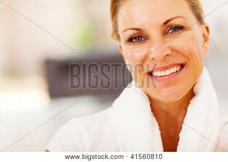 fit middle aged woman closeup portrait with towel on her neck